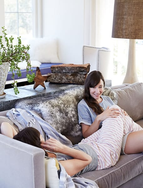 Couple lounging on the sofa in their modern Framingham apartment
