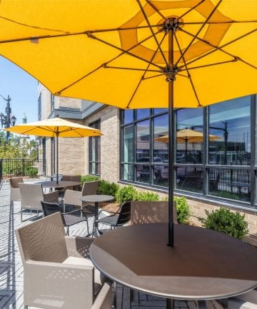 Alta Union House luxury apartments patio table